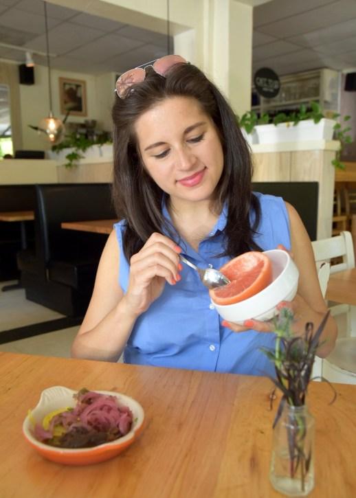 Dania eating grapefruit