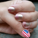 Nails with gold and rose polish. Thumb with American flag.