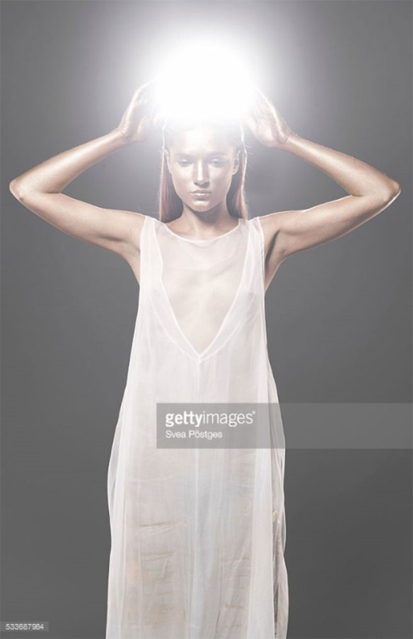 Woman with glowing orb lifted above her head. Photo Credit: Svea Postges - 533687984. gettyimages.com. Published via Alwaysuttori.com. The INTJ Mastermind Series Part 1: The Mastermind Mindset