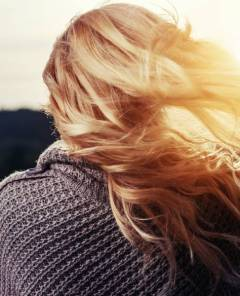 woman's long blonde hair back of head