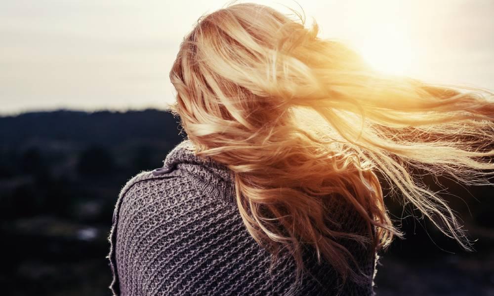 woman's long blonde hair back of head