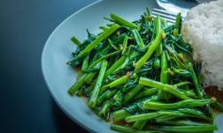 water spinach served on white rice with vegan kecap manis