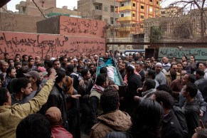 Egyptians carry the coffin of a man killed during Saturday's clashes between protesters and security forces, Zeinhom morgue in Cairo, Egypt, Sunday, Jan. 26, 2014. Egyptian officials said Sunday that the death toll from clashes between security forces and protesters on the third anniversary of the country's 2011 uprising has risen to 49