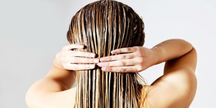 Deep-Conditioning-with-Coconut-Oil How to Use Coconut Oil for Dandruff