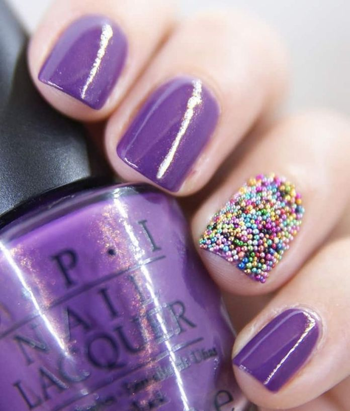 Blue-caviar-is-a-mixture-of-blue-and-purple.-A-good-number-of-tiny-colorful-balls-have-been-attached-to-the-nail-bed-to-have-t-1 2020 Fantastic Nail Design Ideas with Simple Accents