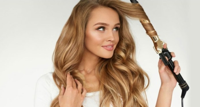 using-curling-hair-tool-2. How to make your hair grow faster?