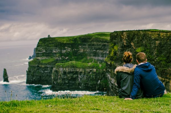 travel couple, move abroad for love, cliffs of Moher, couple in ireland