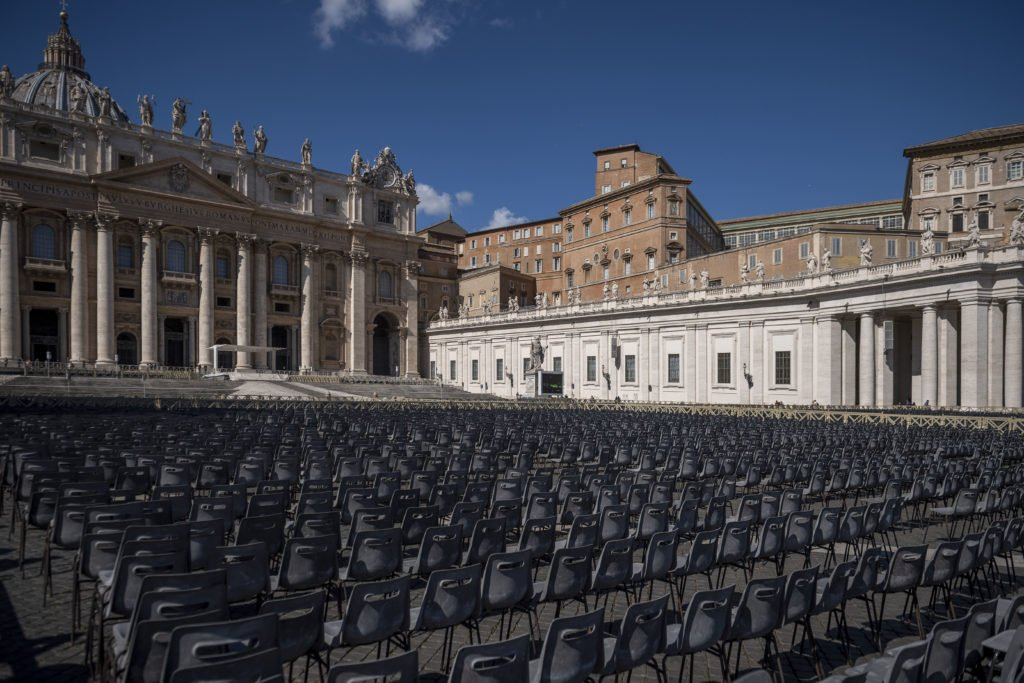 Empty chairs at St. Peter's Square depicting this strange moment in history, pandemic and need for compassion