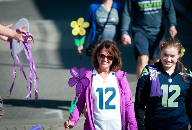 Cassie Moore walks with her aunt, Carol Archambault, during the Seattle Walk to End Alzheimer's in 2014.
