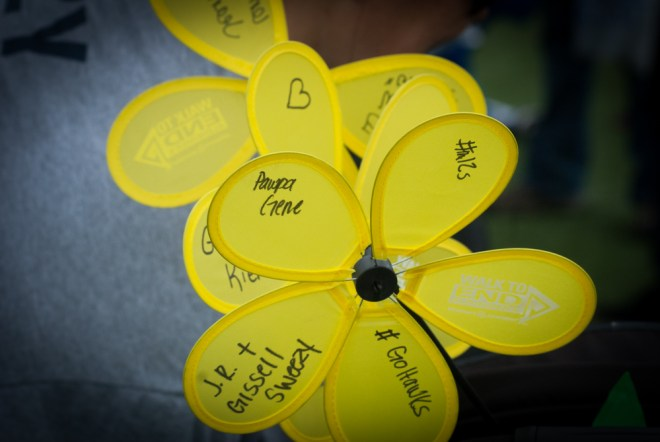 Gissell Sweezy's team wrote on flowers in honor of J.R. Sweezy's grandfather, Gene Wilhelm.