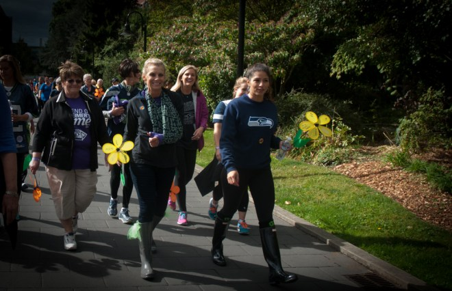 Gissell Sweezy walks with J.R. Sweezy's mother, Susie, and grandmother, Janet, at the Seattle Walk to End Alzheimer's.
