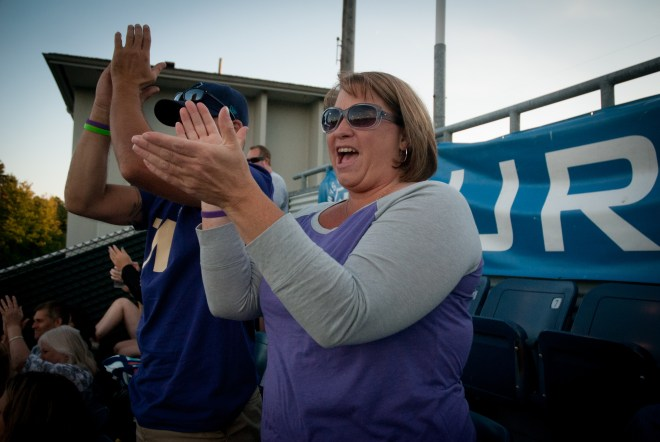 Josey and Eric Holscher cheer after Braden Bishop hit his first professional home run during Alzheimer's Awareness night at the AquaSox Stadium.
