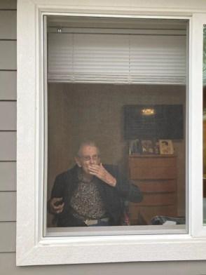 A man looking through a window