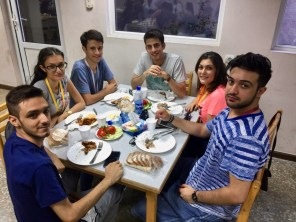Youth from Tehran enjoying fellowship after supper at AMAA (2 Aug. 2018)