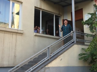 Shogh Center Director and Kids waving goodbye