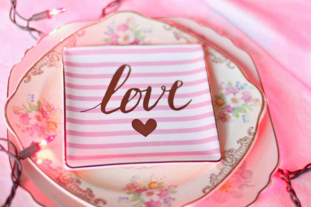 Valentine's Day place setting all in pink with the word love on the napkin.