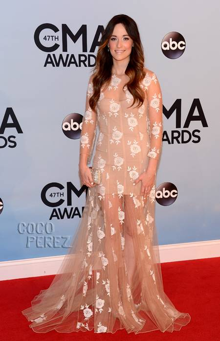 Kacey Musgraves. Not sure how I'm feeling about this dress, I wish it were just a mini - I don't think that the extra sheer fabric was necessary.