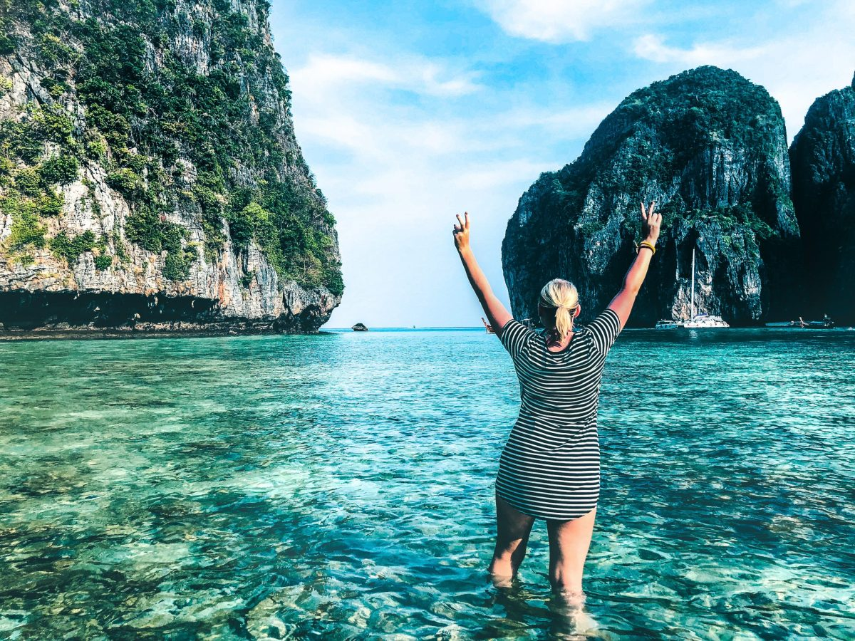 Woman in Maya Bay throwing peace signs