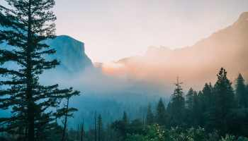 Shot from Tunnel View during sunrise with smoke from a controlled burn in Yosemite