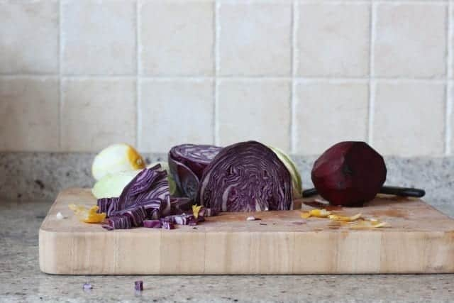 chopping cabbage for purple pickle