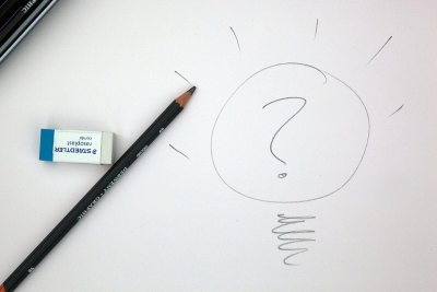 White Paper with a drawing of a lightbulb, with a question mark inside.