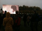 Berliners watch a documentary about the Wall at Mauerpark
