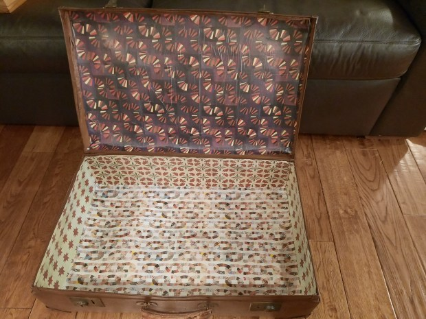 Updating a vintage suitcase with a paper lining