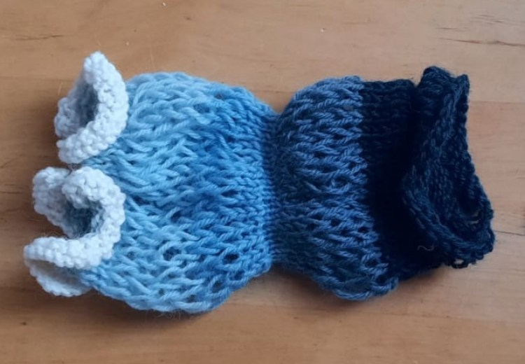 Knitted cuff in five shades of blue and also white, an experimental piece by by Amanda Jane Ogden