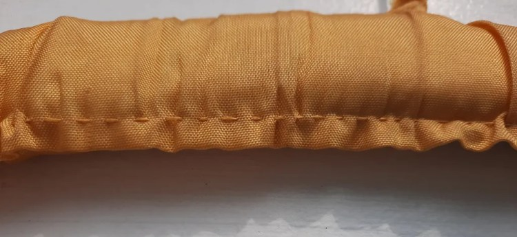 hand stitching on a coathanger covered in vintage fabric