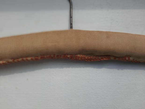 a coathanger covered in vintage fabric 3