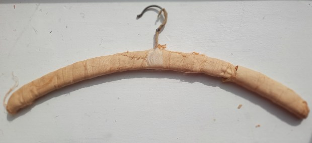 stocking used to pad a vintage hanger