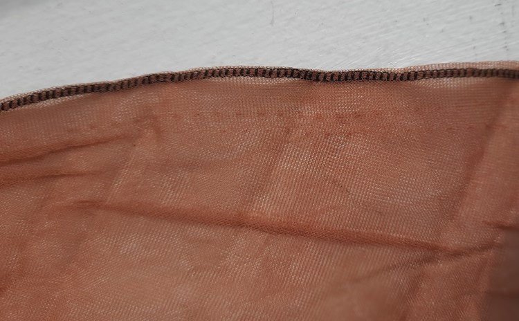 stockings used to bind a vintage coathanger