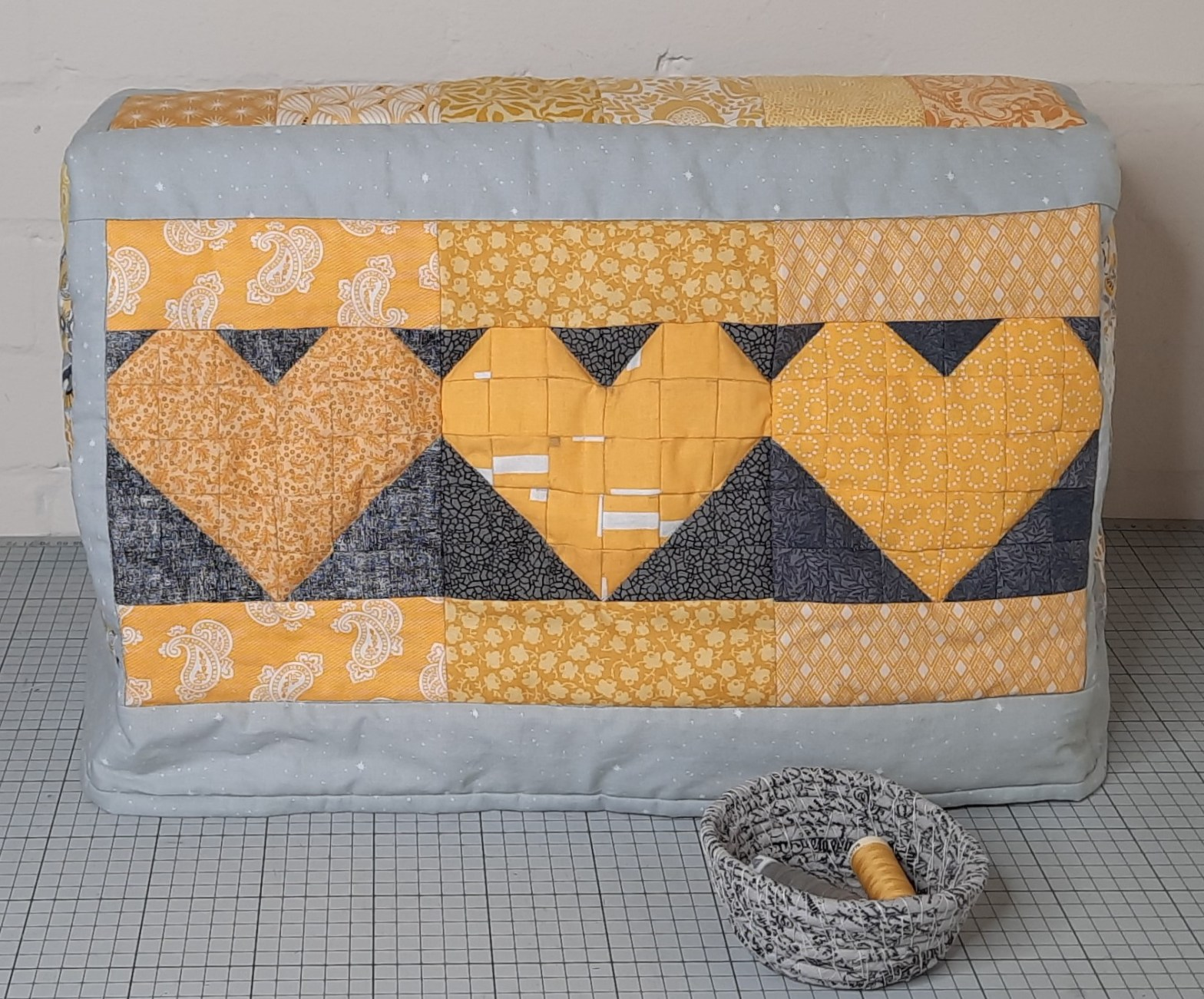 a grey and yellow patchwork sewing machine cover, a new pattern by Amanda Jane Textiles