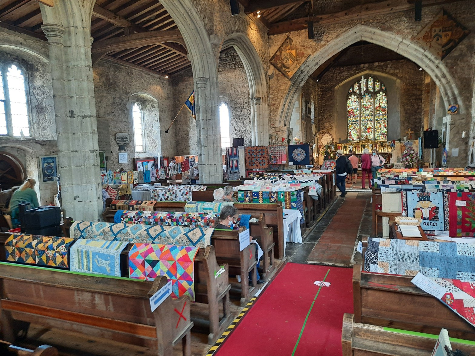 The interior of a church being used for Ethelburga's quilt show, Lyminge, 2021