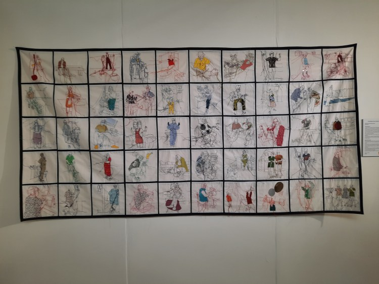 'Waiting for this meeting to start' by Rosie James - a composite embroidery of many individuals doing different activities in lockdown