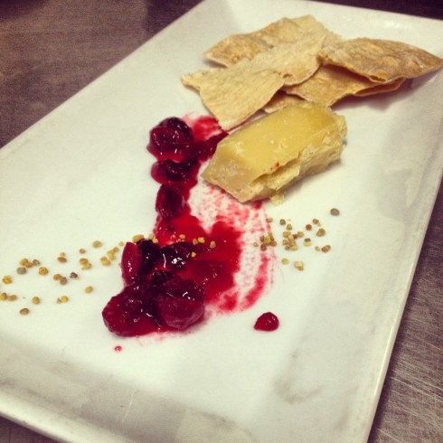 Cheese and crackers with raspberry jam