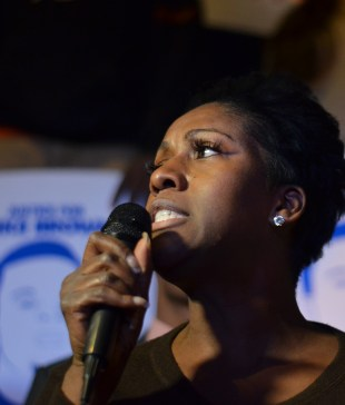 "Charlene Tarver, Esq. speaks at a protest against the grand jury decision to not indict Officer Darren Wilson in the death of Michael Brown on November 25. Tarver thanked Phoenix for ""standing up, and saying that where there is an injustice in America, Phoenix is going to make sure its voice is heard."" (Amanda LaCasse/DD)"