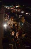 Crowds enjoy the art walk late into the night.