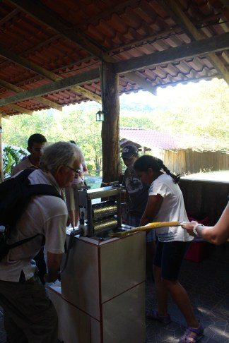 Ron helping to juice the sugar cane for a yummy drink