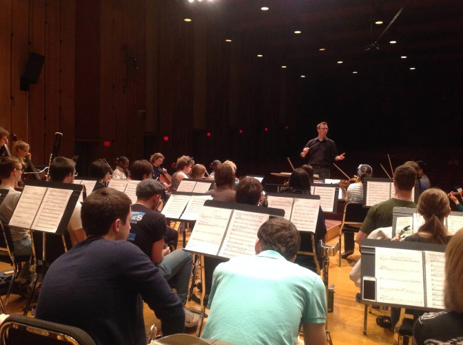 Matt Sadowski conducts in Ford Hall at the dress rehearsal on March 17.