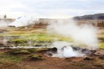The land surrounding Iceland's main geysers, Geysir and Strokkur, is scattered with boiling streams and steam vents. The entire area smells like rotten eggs, thanks to the natural gases found in the hot springs.