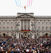 LONDON, ENGLAND - JUNE 13: The Red Arrows fly over Buckingham Palace as the Royal Family look out from the balcony of Buckingham Palace during the Trooping the Colour on June 13, 2015 in London, England. The ceremony is Queen Elizabeth II's annual birthday parade and dates back to the time of Charles II in the 17th Century when the Colours of a regiment were used as a rallying point in battle. (Photo by Chris Jackson/Getty Images)