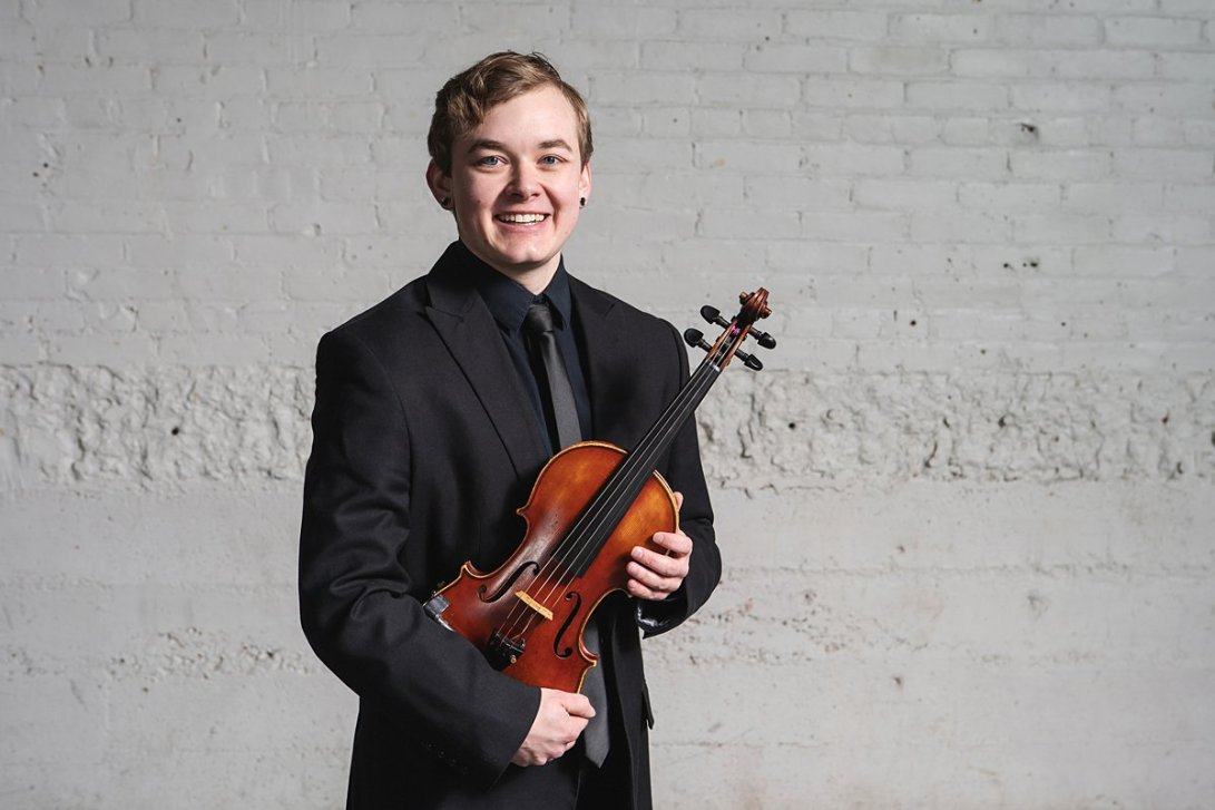 person smiling with a violin