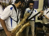 Saxophonist Prateek Thakur and bass player Thomas Abdelmalak improvise during a timeout at a CAA tournament game between Hofstra and Elon. March 9, 2017. James Madison University, Harrisonburg, Virginia.