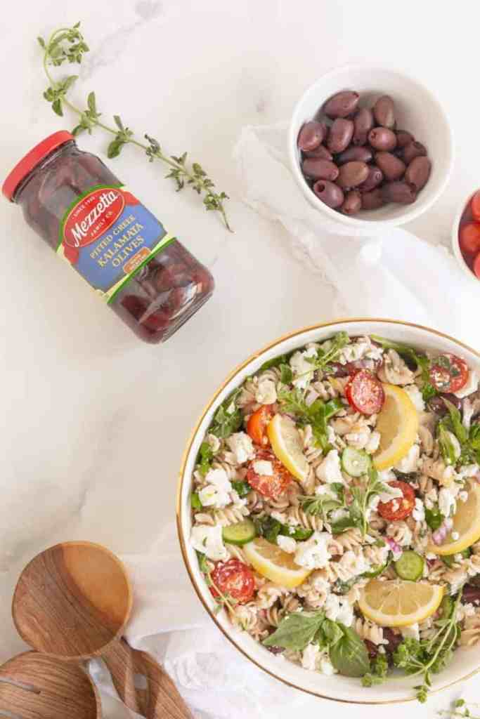 overhead of pasta salad in bowl with ingredients