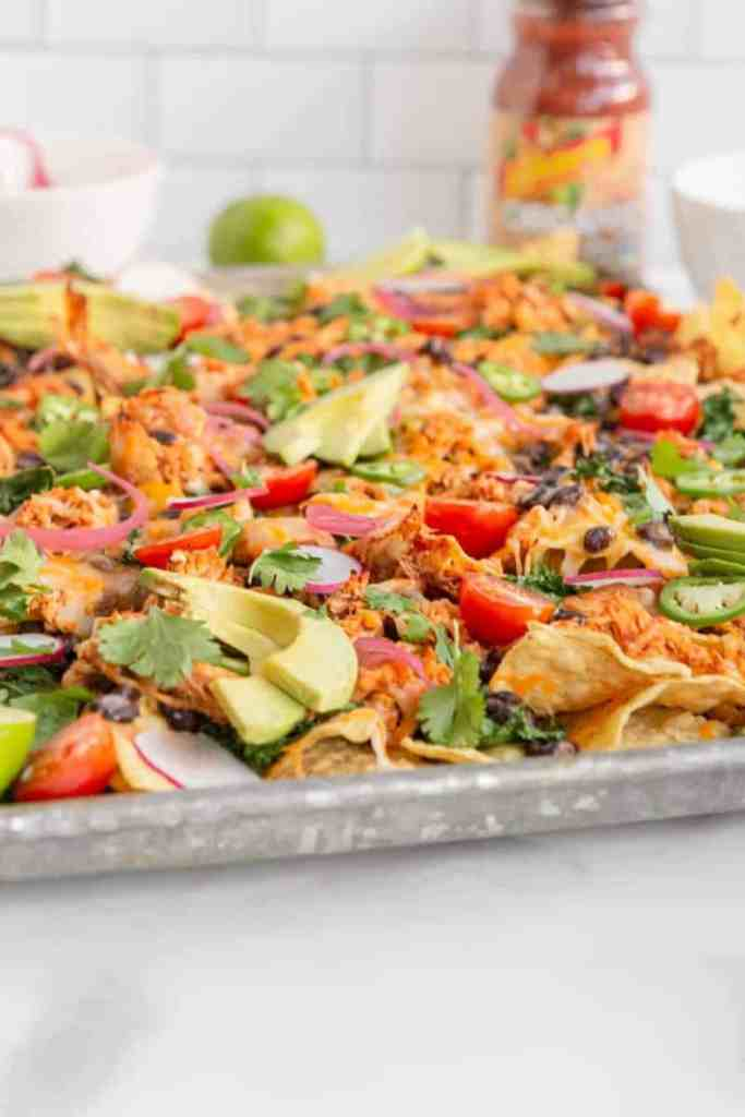 side view of nachos on a pan