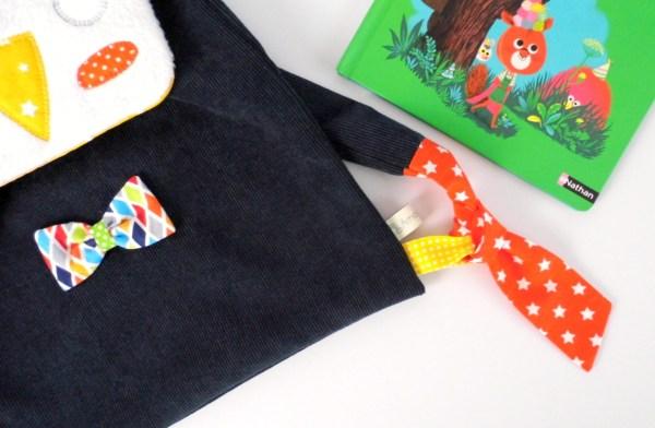 sac-ecole-maternelle-brode-prenom-bleu-marine-orange-jaune-moutarde-sac-a-dos-pingouin