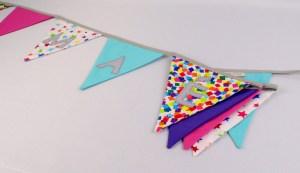 guirlande-fanions-personnalisee-prenom-fille-mae-deco-chambre-bebe-fille-rose-violet-bleu-turquoise-amanite-rose