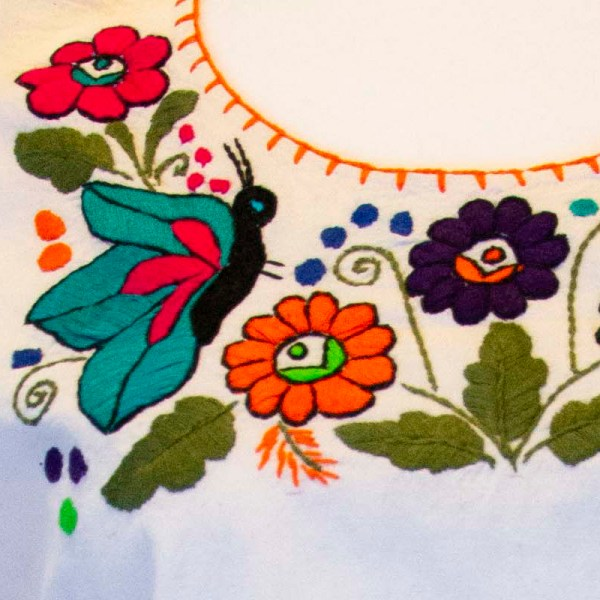 Traditional handmade Mexican embroidered white blouse made of cotton detail view
