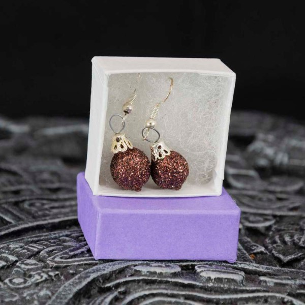 Pair of handblown Christmas glass earrings shown in a box